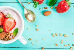 Yogurt with granola, nuts and fresh strawberry Royalty Free Stock Images