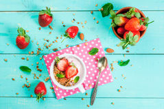 Yogurt with granola, nuts and fresh strawberry Stock Photo
