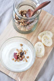 Yogurt with granola on top view Royalty Free Stock Image