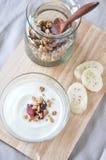 Yogurt with granola on top view Royalty Free Stock Image