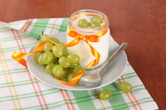 Yogurt with grapes Royalty Free Stock Images
