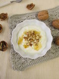 Yogurt with honey and walnuts Stock Photo