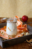Yogurt and a jar with dried apricots and nuts Stock Image