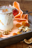 Yogurt in a jar of nuts and apricots Stock Images