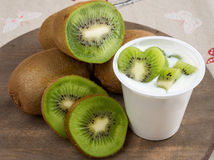 Yogurt with kiwi Stock Images