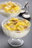 Yogurt with mango and roasted almond sliver Royalty Free Stock Photo