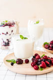 Yogurt with mixed berries. On the table Royalty Free Stock Photo