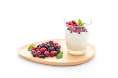 Yogurt with mixed berries. On white background Stock Image