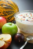Yogurt mixed with fruit pieces Royalty Free Stock Photography