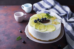 Yogurt mousse cake. On a plate on a brown stone background royalty free stock photo