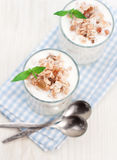 Yogurt and muesli. Natural fresh yogurt and muesli in a glass stock photo