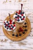 Yogurt, muesli and berries of blueberry and stone bramble Royalty Free Stock Photos