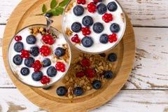 Yogurt, muesli and berries of blueberry and stone bramble Stock Photo