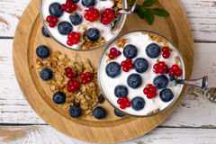 Yogurt, muesli and berries of blueberry and stone bramble Royalty Free Stock Photo