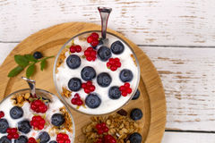Yogurt, muesli and berries of blueberry and stone bramble Royalty Free Stock Photos