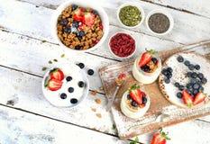 Yogurt, muesli, berries, goji and chia seeds for Healthy diet Br Royalty Free Stock Photos