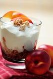 Yogurt with muesli and fruit Stock Images