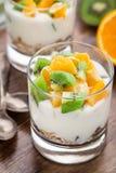 Yogurt with muesli and fruits Stock Images