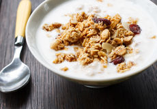 Yogurt with muesli. Homemade yogurt with muesli on wood Royalty Free Stock Photography