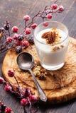 Yogurt muesli with pecan nuts. Glass of delicious yogurt muesli with pecan nuts on wooden background Stock Photo