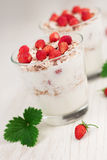 Yogurt with muesli and strawberries Stock Images