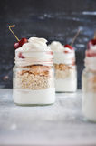 Yogurt with muesli and strawberry on a wooden table Royalty Free Stock Photo
