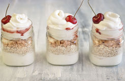 Yogurt with muesli and strawberry on a wooden table Royalty Free Stock Photography