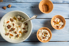 Yogurt with nuts, almonds and raisins as ice cream Stock Photo