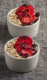 Yogurt with oat flake and fresh berries for healthy morning meal put on white wood background, Stock Image