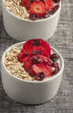 Yogurt with oat flake and fresh berries for healthy morning meal put on white wood background, Royalty Free Stock Photography