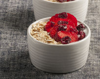 Yogurt with oat flake and fresh berries for healthy morning meal put on white wood background, Royalty Free Stock Photos