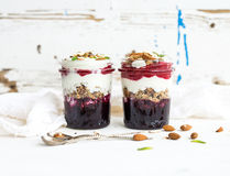 Yogurt oat granola with berries, honey and nuts in Royalty Free Stock Photo