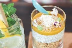 Yogurt oat granola with mango mousse royalty free stock images