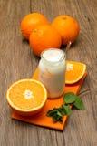 Yogurt with orange Stock Photos