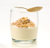 Yogurt and organic cereals with golden spoon Royalty Free Stock Photos