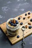 Yogurt parfait with blueberries and granola stock photography