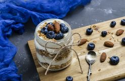 Yogurt parfait with blueberries and granola royalty free stock photos