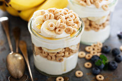 Yogurt parfait with cereal and banana Royalty Free Stock Image