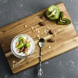 Yogurt parfait with kiwi and granola royalty free stock images
