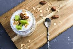 Yogurt parfait with kiwi and granola stock images