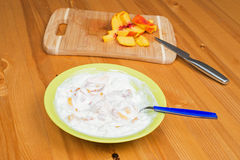 Yogurt with peach. On a wooden surface Stock Image