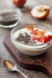 Yogurt with peaches, chia seeds Stock Photos