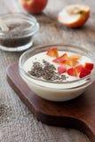 Yogurt with peaches, chia seeds Stock Image