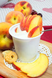 Yogurt with peaches Stock Photos