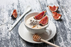 Yogurt with pieces of fig, chia seeds Royalty Free Stock Image