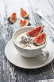 Yogurt with pieces of fig Stock Photo