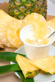 Yogurt with pineapple Stock Images