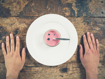 Yogurt on plate with male hands Stock Image