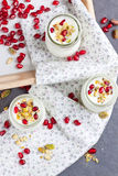 Yogurt and pomegranate seeds Royalty Free Stock Images