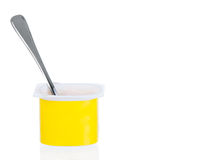 Yogurt pot with spoon Stock Photo